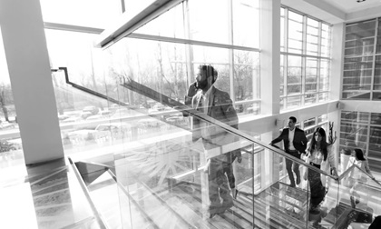 young business people climb stairs in office