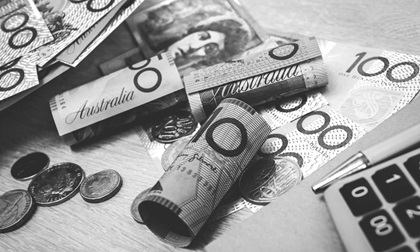 Monetary value of Australian dollars with notebook and calculator