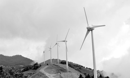Wind turbines spins in rural area of Costa Rica