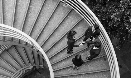 Business people standing at staircase