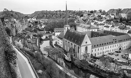 Panoramic view on Luxembourg City - Alzette river, church of St Jean du Grund and Abbey de Neumunster.