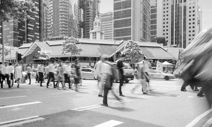 People crossing the street in Singapore