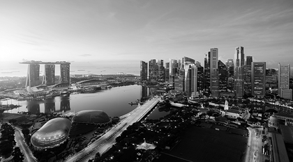 aerial view of singapore business district and city at sunset