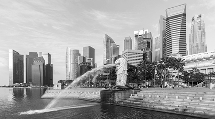 view of central singapore with the merlion fountain and marina bay