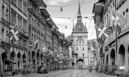 black and white image of shopping alley in Bern, Switzerland and the clocktower