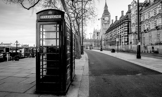 iconic british old red telephone box with the big ben nearby