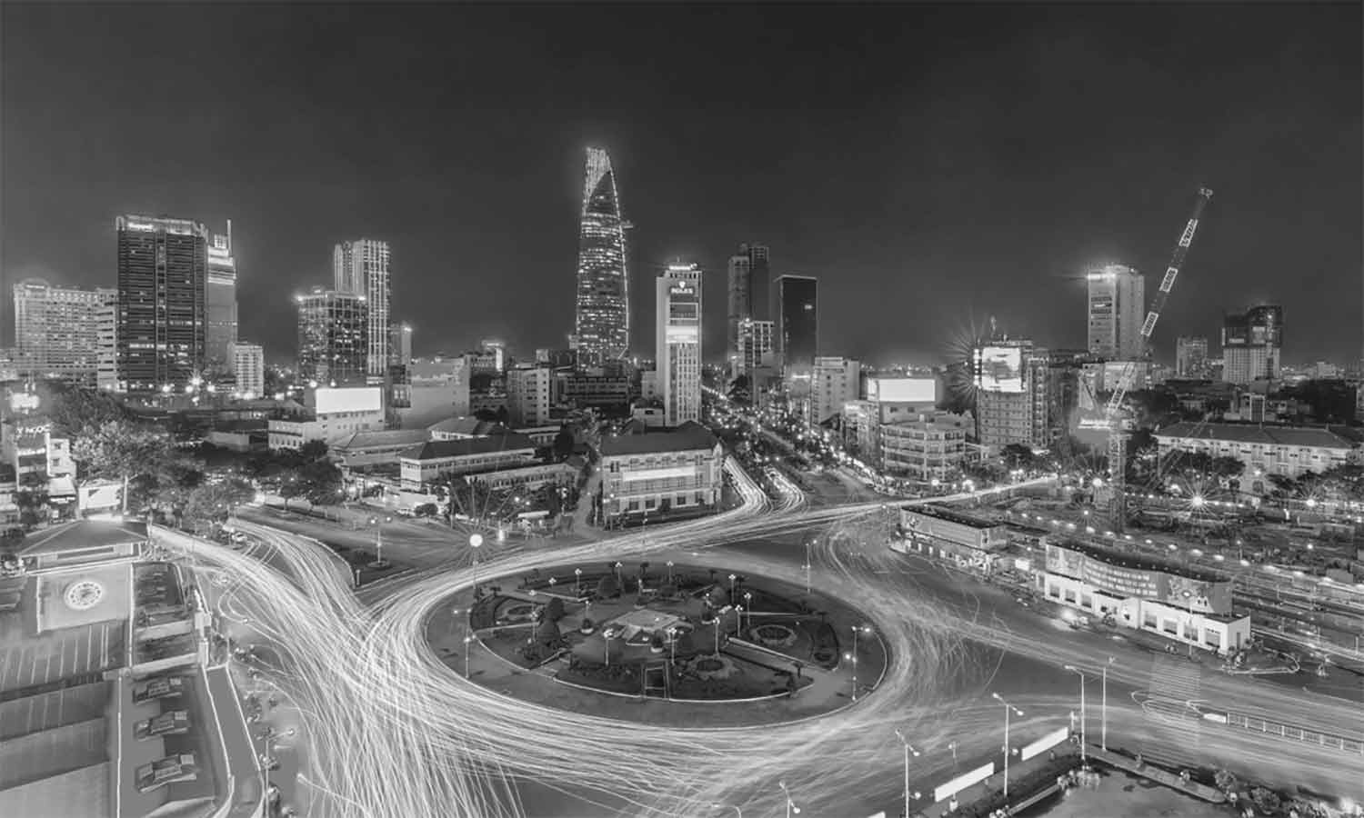 Ho chi minh city roundabout car lights up night view