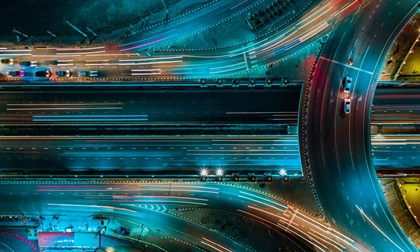 Aerial view of expressway and road traffic at night