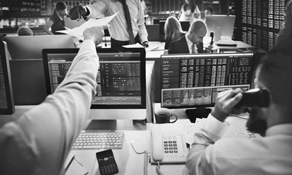 Busy working people in stock exchange
