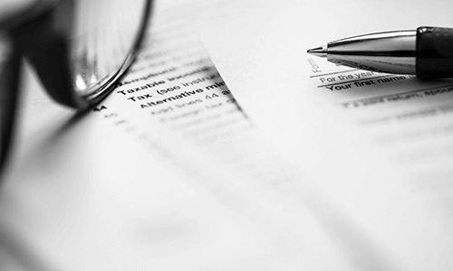 Tax paperwork with glasses and pen