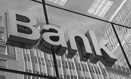 The word BANK on a glass reflection