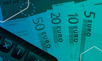 Euro notes fanned out with blue overlay