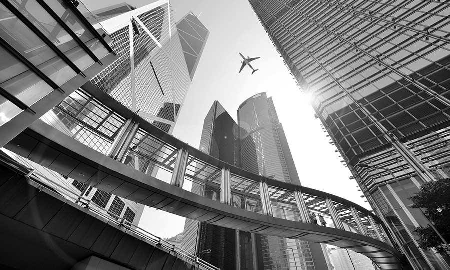 Modern building with airplane flying