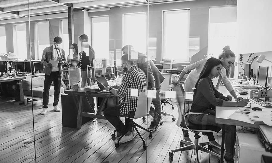 Group of young business people working and communicating together in creative office