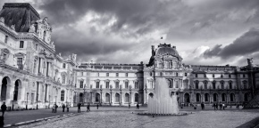 External view of the Louvre museum in Paris, with fountain in foreground