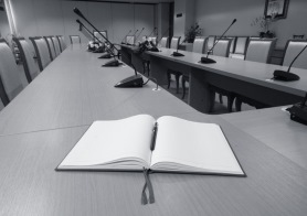 An open notebook on a board room table