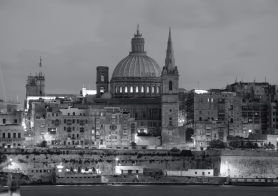 night view of Valletta with St. Pauls Cathedral and Charmelite Church at twilight