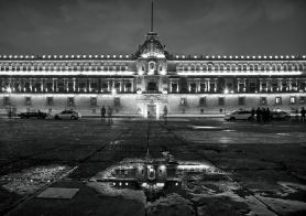Illuminated National Palace in Plaza de la Constitucion of Mexico City at Night. Zocalo and Army Square are among other local names of this place.